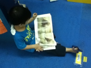 Jaden having some me-time with a picture book. Shh!