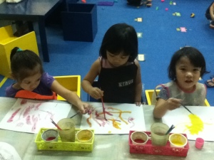 Little Picassos: Pipop, Lexi, and Sia found out that a combination of red and yellow produces orange!