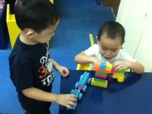 Basti and Eli transforming the table into a construction site!