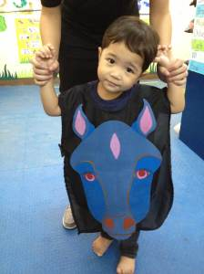 Look! Adriel wears the Blue Horse costume.
